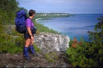 Sue fFeeman gazes over Georgian Bay along the Bruce Trail.