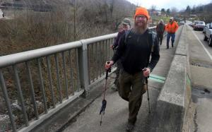 Great Eastern Trail through-hikers Bart Houck and Joanna Swanson cross the Tug Fork River and enter West Virginia, the approximate halfway point on their 1,800-mile, nine-state trek. Accompanying them are TuGuNu Hiking Club members Tim McGraw and Paul Kenney.