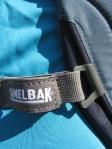 Breast strap slider on a CamelBack Cloud Walker day pack.